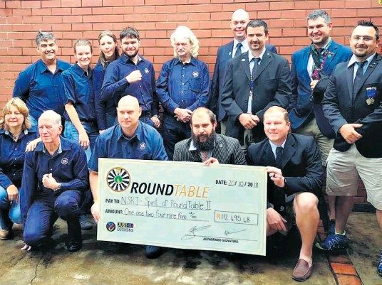 ??  ?? Givers and receivers. NSRI and Round Table members share the moment as the super cheque is handed over (back): Eugene Cummings, Liz Gilbert, Claire Chase, Ryan Chase, Andrew Hodgson, Boela Bekker, Martin van der Linde, Kevin Boonzaaier, Johan Herselman (front): Brynn Gericke, Mike Patterson, Manie le Roux, Francois Minnie and Jean Schoonhoven