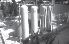 ?? GALIH ADI PRASTEYO/JAWA POS ?? INSTALASI PENGOLAH: Inilah mesin pemurni air di Kampung Jagir.