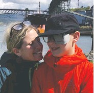 ?? HANDOUT, KIMBERLY BERGER / THE CANADIAN PRESS ?? Kimberley Berger of Vancouver with son Jonah, who had to go to Seattle for proton treatment for a brain tumour.