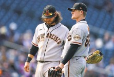 ?? David Zalubowski / Associated Press ?? Giants shortstop Brandon Crawford (left) joins starter Logan Webb on the mound. Webb was pulled in the fourth inning.