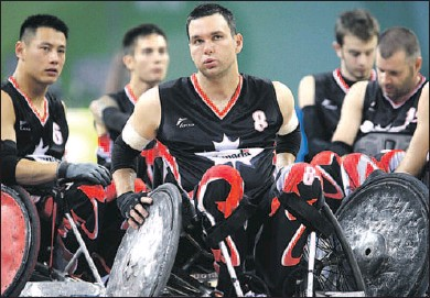 ?? CPC photo: Mike Ridewood ?? TOUGH LOSS: Harrow's Mike Whitehead, centre, and his teammates show their disappointment after Canada's 41-40 loss to Australia in wheelchair rugby semifinal action Monday at the Paralympic Games in Beijing. Whitehead scored 13 goals for the Canadians,...