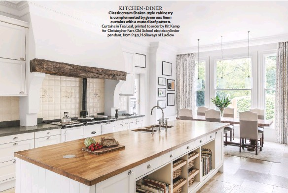 ??  ?? KITCHEN-DINER Classic cream Shaker-style cabinetry is complemented by generous linen curtains with a muted leaf pattern. Curtains in Tea Leaf, printed to order by Kit Kemp for Christopher Farr. Old School electric cylinder pendant, from £130, Holloways of Ludlow