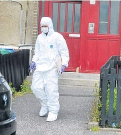 ?? Picture: George McLuskie. ?? A scenes of crime officer on Harris Drive yesterday.