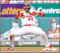 ?? Jeff Roberson The Associated Press ?? Edmundo Sosa celebrates Sunday after hitting an RBI double in a five-run first inning by the Cardinals, who beat the Padres 8-7.
