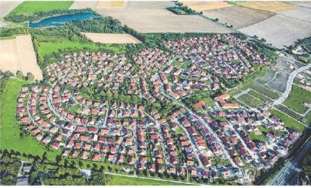 ??  ?? Steigt oder sinkt die Belastung? Ein Wohngebiet mit Einfamilienhäusern. Foto: Julian Stratenschulte/dpa