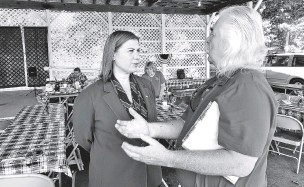 ?? DAVID EGGERT/ASSOCIATED PRESS ?? Rep. Elissa Slotkin, D-Mich., talks with a constituent after a veterans event Friday at the Ingham County Fair in Mason, Mich. Slotkin, who flipped the 8th Congressional District by defeating a Republican incumbent in 2018, has not yet backed an impeachment inquiry of President Donald Trump.