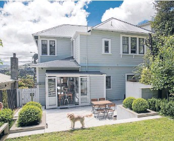 ?? Photos: JOHN NICHOLSON/FAIRFAX NZ ?? Fine pedigree: The architect was asked to transform the home without compromisi­ng the exterior while changing the room sizes and shapes to suit a family with three young children. And Jack the family dog.