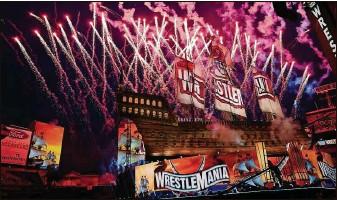 ?? LUIS SANTANA   Times ?? Fireworks fill the sky Sunday night during the opening of WrestleMania 37 at Raymond James Stadium.