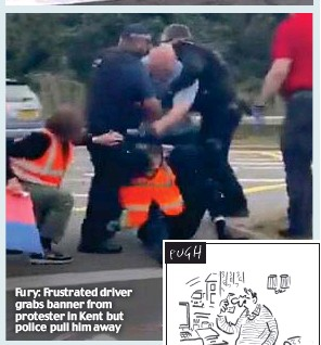 ??  ?? Fury: Frustrated driver grabs banner from protester in Kent but police pull him away