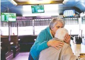 ?? PHOTOS BY KATHERINE FREY/THE WASHINGTON POST ?? Donna Rock kisses Tastee Diner regular George Jones. A plan would turn the diner into a medical marijuana dispensary, and some locals are worried about the diner's longtime connections being lost.