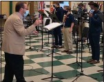?? DAVE FAZZINI — SCREENCAP VIA YOUTUBE ?? Dave Fazzini (left), director of choirs at Notre Dame Prep, rehearses with Men's Glee Club at the school.