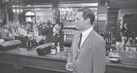 ?? AP ?? A wax statue of Don Draper stands by the bar at Peter Luger Steakhouse.