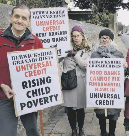 ??  ?? 0 Protesters in Berwickshire demonstrate following problems with the introduction of Universal Credit