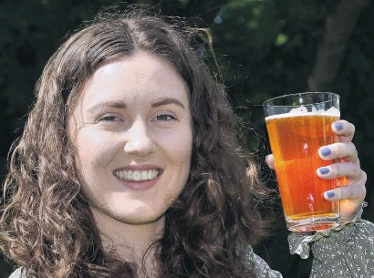 ?? PHOTO: GREGOR RICHARDSON ?? Dunedin food science hops researcher Victoria Purdy with a craft beer.