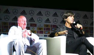 ?? — REUTERS/Leon Kuegeler ?? BIG RESPONSIBILITY: Germany coach Joachim Loew with a hologram of Russia coach Stanislav Cherchesov during the press conference.