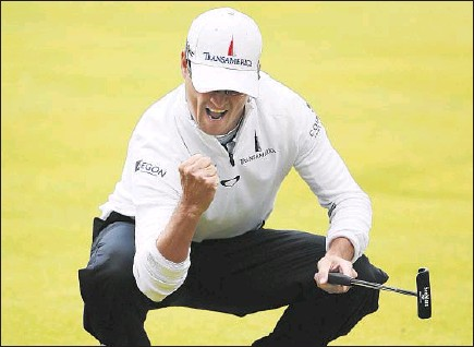 ?? Russell Cheyne Tribune News Service ?? A BIRDIE at No. 18 made Zach Johnson the clubhouse leader and ultimately got him into four- hole, three- man playoff, which he won.