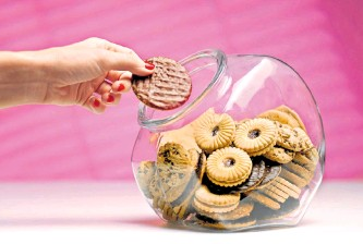 ??  ?? Taking the biscuit: it's more exercise that we need, not calorie-counting