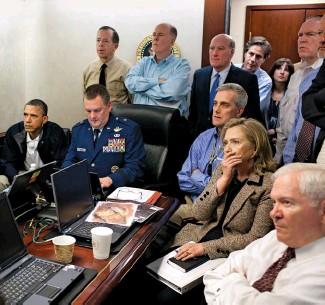 ??  ?? RETRIBUTION Top: President Barack Obama, Vice President Joe Biden, Secretary of State Hillary Clinton and members of the national security team get an update on the mission against Osama bin Laden (middle) in the Situation Room of the White House. Left: People walk past the compound where bin Laden was killed on May 2, 2011, nearly a decade after the events of 9/11.