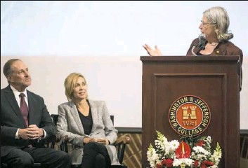 ?? Steph Chambers/Post-Gazette ?? Tori Haring-Smith, right, president of Washington & Jefferson College, introduces her successor, John C. Knapp, left. Seated next to Mr. Knapp is his wife, Kelly.