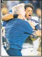 ?? TONY AVELAR / ASSOCIATED PRESS ?? Seattle Seahawks head coach Pete Carroll, left, celebrates with quarterback Russell Wilson after the Seahawks defeated the San Francisco 49ers.