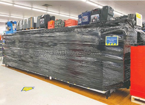 ?? JOHN MAHONEY / POSTMEDIA NEWS ?? Entire aisles of non-essential goods are covered in plastic wrap on Sunday at Walmart store in Dorval, west of Montreal.