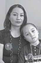 ??  ?? Leticia Aguilar with her son Jordan Hinojosa, 6, wearing pins remembering her aunt and grandmother.