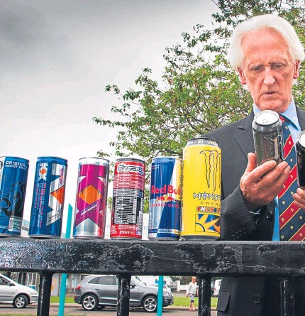 ?? Pictures: Paul Reid and Kim Cessford. ?? Melvyn Lynch at Forfar Academy with some of the drinks he is concerned about. The Courier salutes his bold step in banning the drinks from his school, and would now urge other schools to follow in his trail-blazing footsteps.