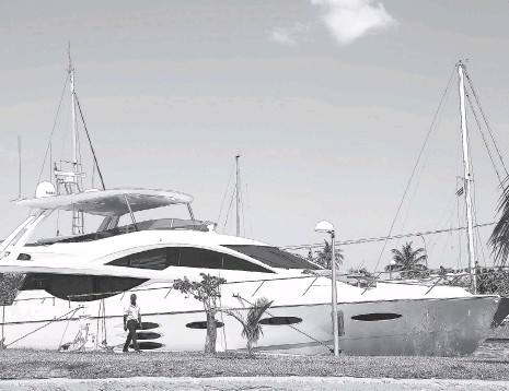 ?? AP ?? A security guard walks beside the US yacht Still Water, moored at the Hemingway Marina in Havana, Cuba, Thursday, August 6, 2015. For the first time in decades, the American government is authorisng a wide range of large-scale sea travel to Cuba.