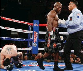 ?? (AP) ?? TIMOTHY Bradley knocks down Brandon Rios for the first time during their WBO welterweight title in Las Vegas.