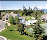 ??  ?? Above: The view from the Hendrys' master bedroom encompasses mountain and ocean views as well as looking over the development's clubhouse with tennis courts and outdoor pool. Single-family homes are also part of Craig Bay development.