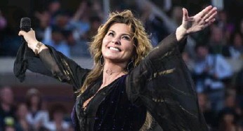 ?? CHARLES SYKES/INVISION/THE ASSOCIATED PRESS ?? Shania Twain's Now is, like most of her albums, not quite country music, though it is a smaller and warmer sound.