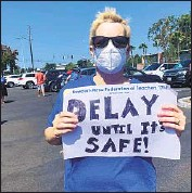 ?? Kimberly Claytor Newport-Mesa Federation of Teachers ?? THE PROTEST in Costa Mesa, above, ref lects a survey that said teachers fear contracting the virus and that districts are rushing in-person classes.
