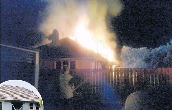 ?? Photo / Paul Taylor ?? A house on Grove Road was significantly damaged following a fire.