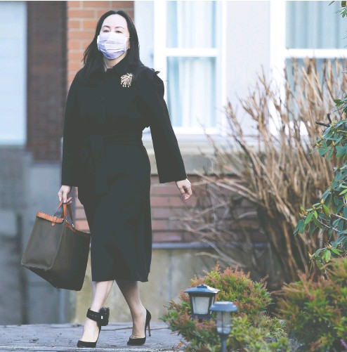 ?? JONATHAN hayward / THE CANADIAN PRESS ?? Huawei chief financial officer Meng Wanzhou leaves her home in Vancouver on Wednesday. Meng, who is free on bail