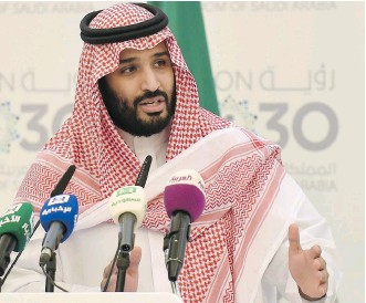 ?? FAYEZ NURELDINE/AFP/GETTY IMAGES ?? Prince Mohammed bin Salman, Saudi defence minister and deputy crown prince, heads economic policy-making. Included in his plan is a partial initial public offering of Aramco.