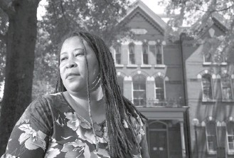 """?? KARL Merton FERRON/BALTIMORE SUN ?? """"How did I not know this?"""" said La'tanya Christopher, shown in front of the old Salisbury courthouse. It was not until activists researched history that she learned that her ancestor, Garfield King, was lynched in 1898. A new courthouse marker memorializes King and two other victims of lynching."""