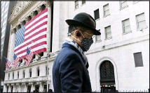 ?? (AP) ?? In this file photo a man wearing a mask passes the New York Stock Exchange in New York. Stocks were edged mostly lower on Wall Street Tuesday, June 15, a day after the S&P 500 and the Nasdaq hit their latest record highs.