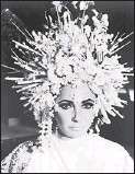 """?? Universal Pictures/Photofest ?? 1977: Taylor stepped out 1970s style with this extravagant, pearl and flower headpiece. """"What better year to wear it?"""" Duke says. """"Anyone who wears something like that, it says a lot about her spirit. She was a lot of fun."""""""