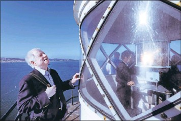?? KARL MONDON/STAFF PHOTOS ?? Architect Gene Grulich visits the top of the 161-year-old Alcatraz lighthouse Monday in San Francisco. He will prepare an architectural study determining the scope and cost of the rehabilitation of California's first lighthouse.