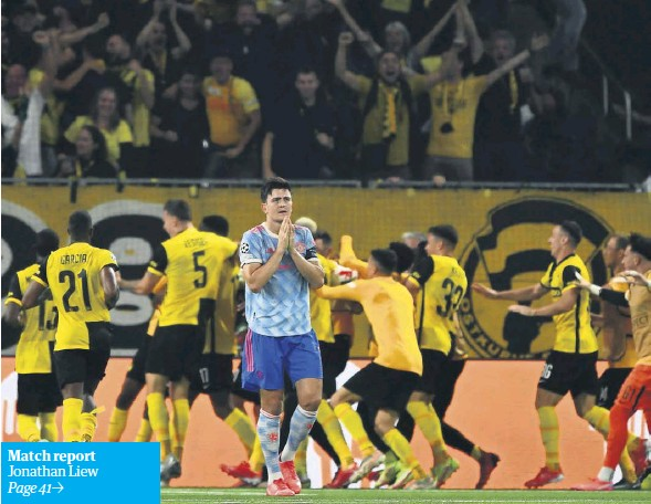 ?? FABRICE COFFRINI/ AFP/GETTY IMAGES ?? ▲ Harry Maguire shows his frustration after Young Boys celebrate their late winner against Manchester United