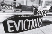 ?? THE ASSOCIATED PRESS ?? Demonstrators held signs in front of the Edward W. Brooke Courthouse in Boston in January.