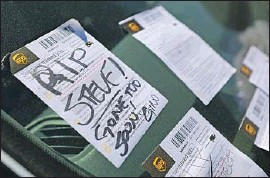 ?? K.C. Alfred The San Diego Union-Tribune ?? NOTES cover the car of 30-year UPS employee Steve Krueger at the company's facility that he worked from in San Diego's Kearney Mesa area. Krueger was 61.