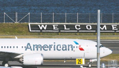 ?? EDUARDO MUNOZ / REUTERS ?? American Airlines flight 718 — the first U.S. Boeing 737 Max commercial flight since regulators lifted a 20-month grounding in November — lands Tuesday at LaGuardia airport in New York.