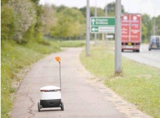 ?? — AFP ?? An autonomous robot called Starship is pictured on its way to deliver groceries from a nearby Co-op supermarket in Milton Keynes.
