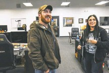 ??  ?? LEFT: Nine Line has 180 employees and boasts about $25 million in annual revenue. RIGHT: Tyler Merritt was on active duty when he and his wife started the company in 2012. Here, he talks to Kaila Donaldson, who runs Nine Line's Facebook page.