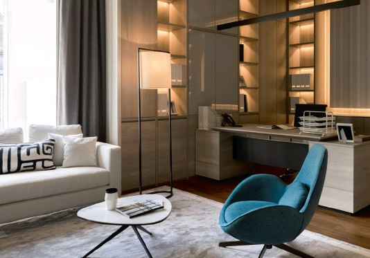 ??  ?? Left to right: The silver-leaf wall panels add a subtle shine to the dining room; to the left of the lift is a console with a Marquina marble top; a sculpture and framed photographs elevate the look of the lift lobby; a blue armchair adds a pop of colour to the handsome home office