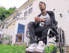 ?? ALLEN G. BREED ASSOCIATED PRESS ?? Rayquan Briscoe sits outside his home in Wilmington, Del., on July 25, 2017. On Nov. 3, 2015, he was walking down Maryland Avenue for an appointment with his probation officer on a drug conviction. He heard gunshots. Briscoe tried to run, but his legs...