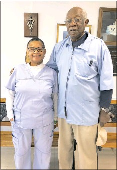 """?? PHOTO BY ANGELA PRICE ?? Karen """"Kay"""" Wright, left, and Dr. Hilliard Gardner recently received a special commendation from the Caroline County Commission for 41 years of service with the county's rabies prevention efforts."""