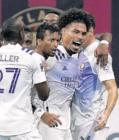 ?? BRYNN ANDERSON/AP ?? Orlando City returns to Exploria Stadium on Saturday against Atlanta United with two goals in mind: reigniting the success of 2020 and continuing a streak of victories over one of the Lions' fiercest rivals.