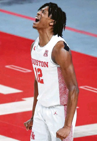 ?? Carmen Mandato / Getty Images ?? UH's Tramon Mark, who finished with 12 points, gets pumped during Sunday's blowout of Cincinnati.